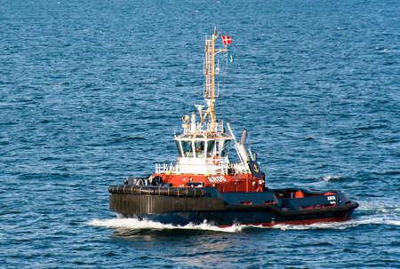 Aarhus, Denmark - July 20, 2017: The tug AROS navigates the port