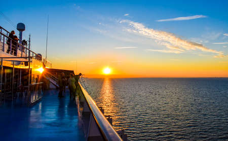 Puttgarden, Germany - July 14, 2017: Sunset on the sea between Germany and Denmark on the Fehmarnbelt waterway, with a view from aboard a passenger ship.