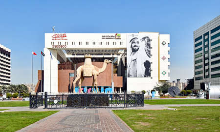 Dubai, United Arab Emirates? February 13, 2018: Exterior of the building on the creek side with a camel statue in front.