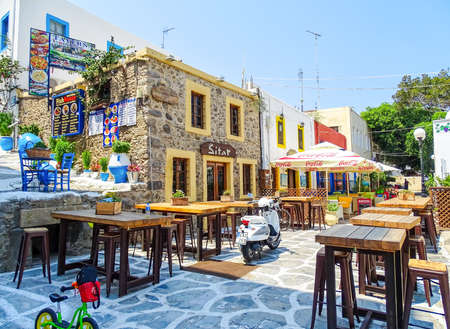 Kos, Greece - July 31, 2015: Taverns in the old town of Kos Town, Kos in Greece. 新聞圖片