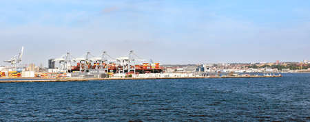 Aarhus, Denmark? July 20, 2017: Panorama of the port of Aarhus in Denmark. The container ship MSC INGY has been docked in the port and is being loaded and unloaded.