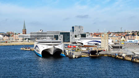 Aarhus, Denmark - July 20, 2017: The high-speed ferries EXPRESS 1 and EXPRESS 2 of the shipping company Molslinjen are moored in the port of Aarhus (Denmark). In the background are historical as well as modern buildings of the city center.