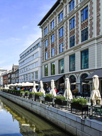 Aarhus, Denmark - July 20, 2017: Promenade along the river ? in downtown Aarhus in Denmark. The many restaurants, cafes and shops along the river attract both locals and tourists.