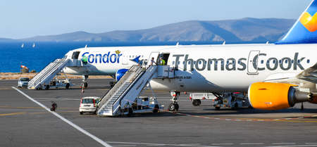 Heraklion, Greece - June 22, 2016: Two Airbus A321 airliners Condor and Thomas Cook are parked on the apron of the