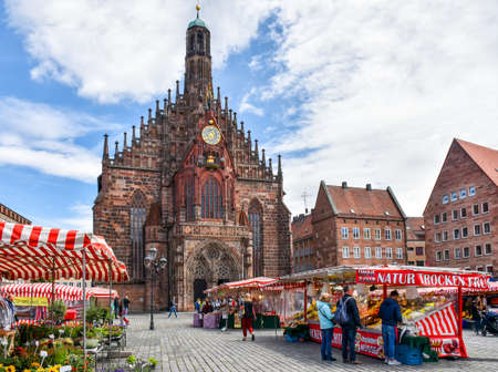 Nuremberg, Germany - June 23, 2018: Market stalls on the market square of the Franconian city of Nuremberg in Germany