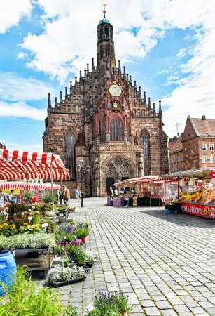 Nuremberg, Germany - June 23, 2018: Market stall in front of the Church of Our Lady at the Franconian city of Nuremberg in Germany