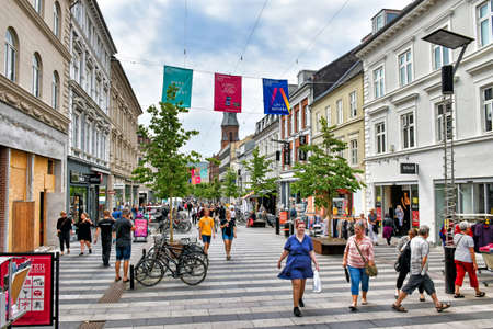 Aarhus, Denmark? July 20, 2017: People stroll along the shopping mile at Ryesgade in the center of the Danish town of Aarhus. Ryesgade is one of Denmark's busiest commercial pedestrian zones.