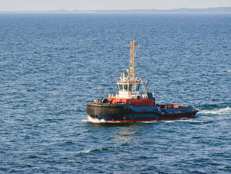 A tugboat navigates on the sea