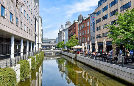 Aarhus, Denmark - July 20, 2017: Promenade along the river � in downtown Aarhus in Denmark. The many restaurants, cafes and shops along the river attract both locals and tourists. 版權商用圖片 - 144637900