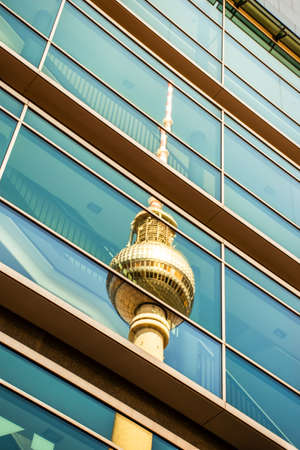 Berlin, Germany ? June 16, 2019: The Berlin television tower is reflected in the glass facade of a modern building 新聞圖片