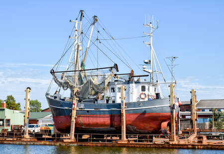Fishing boat in a shipyard in Busum on the North Sea in Germany