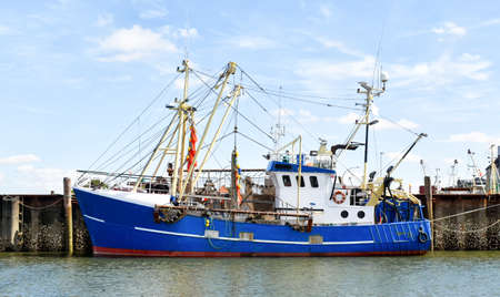 Fishing trawler in the port of Buesum in North Frisia (Germany) 版權商用圖片