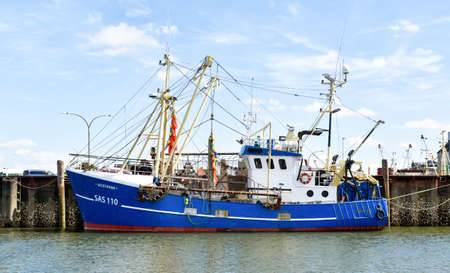 Buesum, Germany? August 1, 2018: Fishing trawler with the name Westbank SAS 110 is moored in the port of Buesum in North Frisia (Germany)