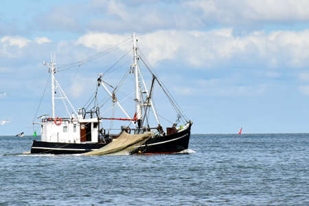 Fishing in the North Sea near Büsum in North Frisia (Germany) 版權商用圖片 - 148314914