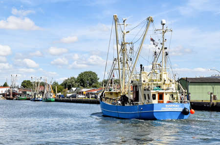 Buesum, Germany? August 1, 2018: A fishing boat enters the harbor of B?sum in North Frisia in Germany.