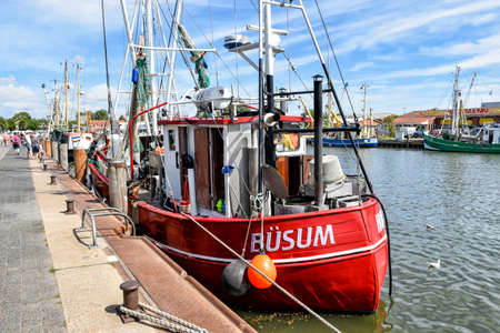 Buesum, Germany - August 1, 2018: A small fishing boat with the name B? SUM is moored in the harbor of Busum in North Frisia in Germany.