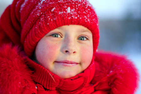 The pink-checked girl in red on a frost photo