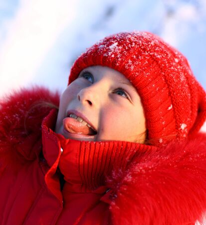 The girl is tasting snow by tongue photo