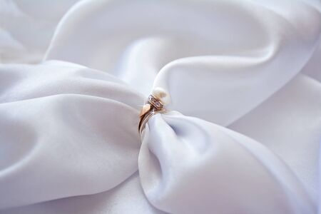 brilliants: Ring with a pearl and brilliants and white sateen
