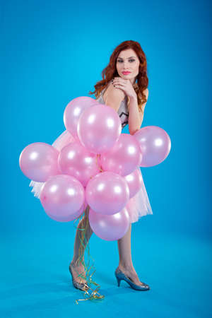 fervent: the amusing girl is celebrating with balloons