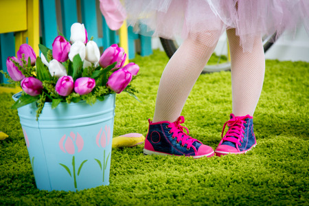 gym shoes: Small legs of the little girl in pink gym shoes