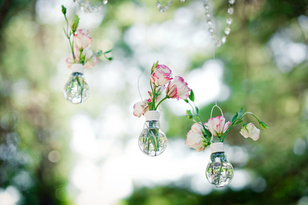 Wedding decor with  flowers of eustoma in bulbs. Decoration of a wedding photoshoot.