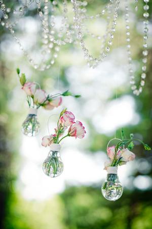 Wedding decor with  flowers of eustoma in bulbs. Decoration of a wedding photoshoot. Vertical. Zdjęcie Seryjne