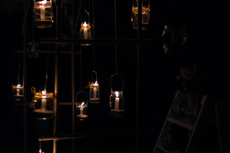 wedding night: Lamps with candles are  hanging  on a tree at night. Wedding night decor. Night ceremony