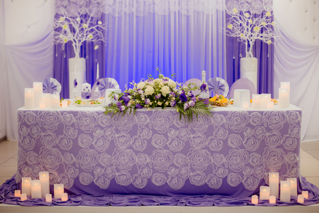 Decorative elements of a wedding table at the wedding banquet. Wedding in lilac and violet color