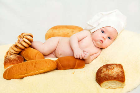 6 9 months: Little baby chef Stock Photo