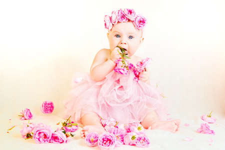Little princess with a crown of roses