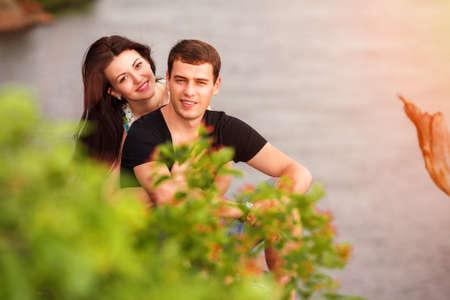 happy couple running on the beach Banco de Imagens