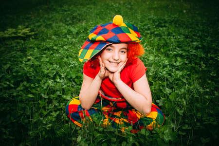 smiling little girl in clown wig