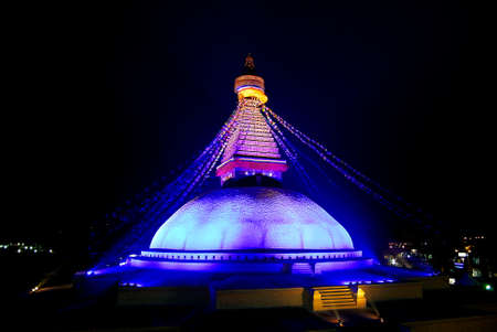 Boudhanath Stupa is one of the holiest Buddhist sites in Kathmandu. The stupa's massive mandala makes it one of the largest spherical stupas in Nepal.  photo