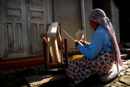 demanded: A woman spins wool thread at Khokana in Lalitpur on Thursday. Sheep wool is highly demanded during the winter season to knit different kinds of clothing to stay warm.