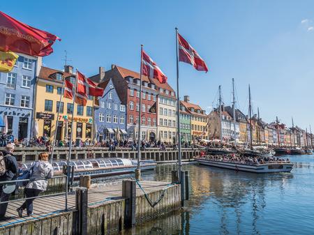 danmark: Lovely Nyhavn port in Copenhagen city centre with Danish flags in the front. Editorial