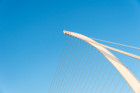 samuel: Close up of famous Samuel Beckett bridge in Dublin, Ireland, in the warm autumn evening against the rearly perfect blue sky.