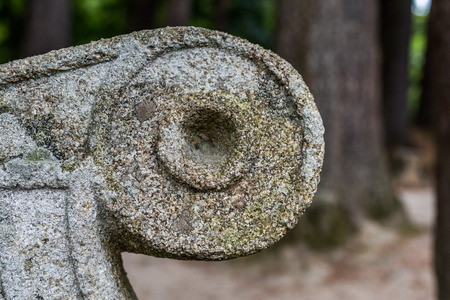 vintage furniture: A close up of ancient Irish stone bench ornament in the park. Man made detail.