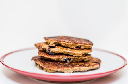 gestational: Home made buckwheat pancakes piled on a plate. Healthy option to cheat gestational diabetes. Stock Photo