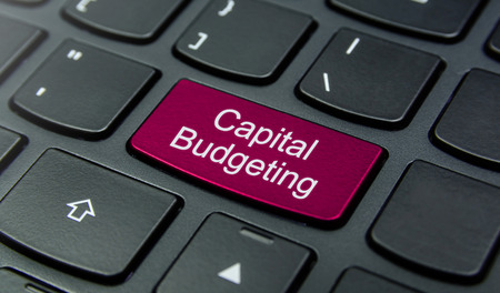 budgeting: Close-up the Capital Budgeting button on the keyboard and have Magenta color button isolate black keyboard