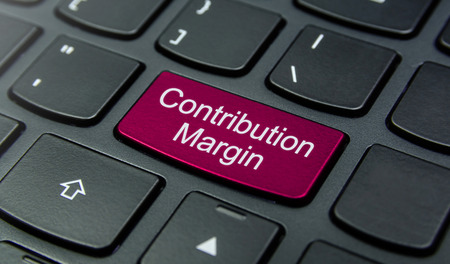 contribution: Close-up the Contribution Margin button on the keyboard and have Magenta color button isolate black keyboard Stock Photo