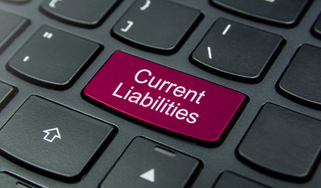 liabilities: Close-up the Current Liabilities button on the keyboard and have Magenta color button isolate black keyboard