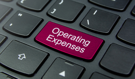 operating key: Close-up the Operating Expenses button on the keyboard and have Magenta color button isolate black keyboard