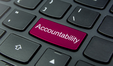 accountability: Close-up the Accountability button on the keyboard and have Magenta color button isolate black keyboard