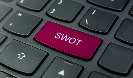 weaknesses: Close-up the SWOT Strengths, Weaknesses, Opportunities, Threats button on the keyboard and have Magenta color button isolate black keyboard Stock Photo