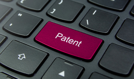 Close-up the Patent button on the keyboard and have Magenta color button isolate black keyboard