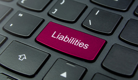 liabilities: Close-up the Liabilities button on the keyboard and have Magenta color button isolate black keyboard Stock Photo
