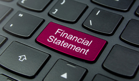 financial statement: Close-up the Financial Statement button on the keyboard and have Magenta color button isolate black keyboard Stock Photo
