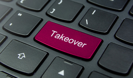 takeover: Close-up the Takeover button on the keyboard and have Magenta color button isolate black keyboard Stock Photo