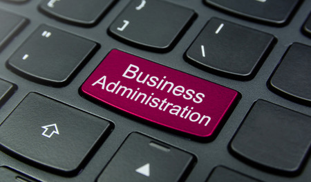 business administration: Close-up the Business Administration button on the keyboard and have Magenta color button isolate black keyboard Stock Photo